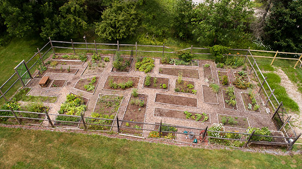 An aerial photo of an outdoor garden with designated plots.