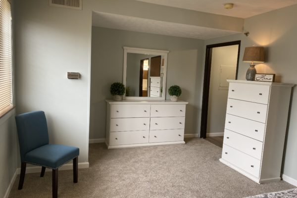 villa bedroom with dressers