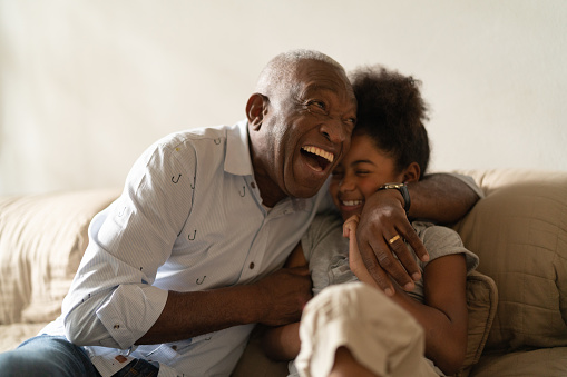 Senior man with granddaughter laughing