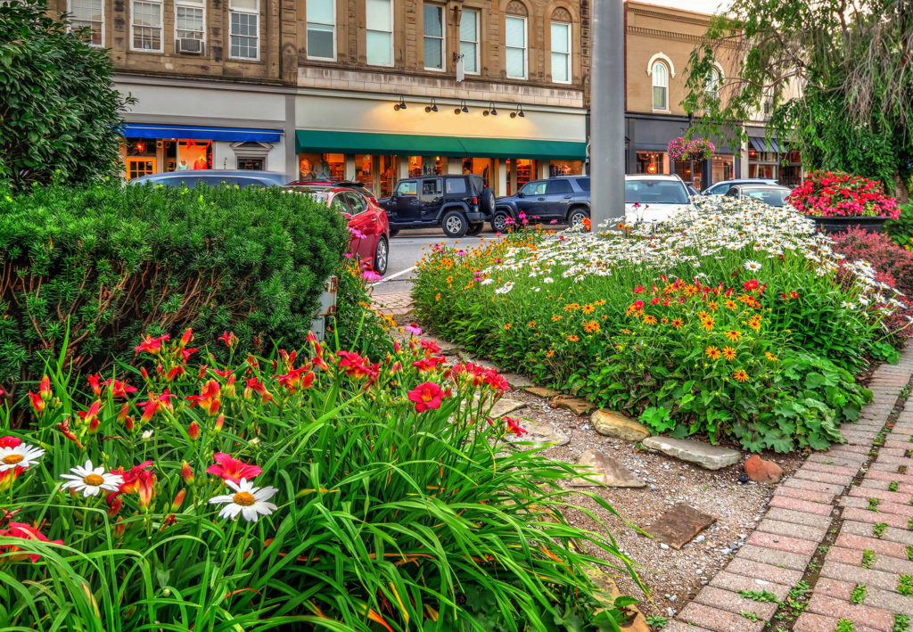 Photo of a flower covered path in historic downtown Chagrin Falls, OH.